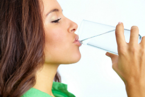 UTI Pain Relief – UTI Treatment - UTI Pain Relief: What You Need to Know - Woman Drinking Water